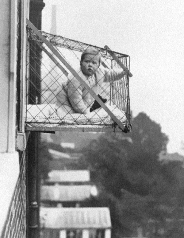 12-Baby-cages-used-to-ensure-that-children-get-enough-sunlight-and-fresh-air-when-living-in-an-apartment-building-ca-1937