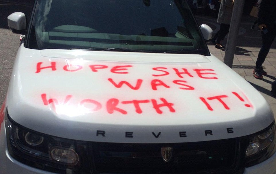 Car in Knightsbridge outside Harrods, spray painted with Hope she was worth it and cheater